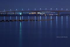 Moonlight Bridge (Antonio Ciriello PhotoEos) Tags: taranto puglia apulia italia italy landscapes paesaggi seascapes marini mare sea canoneos600d canon eos600d 600d rebelt3i tamron 70300vcusd 70300vc 70300 tamron70300vc moonlight luceluna reflections riflessi pontepuntapenna ponte puntapenna bridge pizzone blue blu light luce