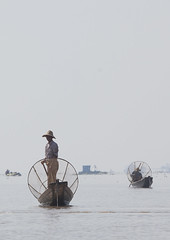 Traditional Fisherman With Fish Trap In Boat, Inle Lake, Myanmar (Eric Lafforgue) Tags: travel lake color colour men net tourism vertical asian outdoors photography boat asia day adult burma transportation rowing effort myanmar inlelake copyspace fullframe fishingboat adultsonly oneperson freshwater shanstate inlay tranquilscene occupation birmanie realpeople traveldestinations  birmania mianmar modeoftransport  traditionally nonurbanscene    1people barma serenepeople  floatingonwater mianm  nauticalvessel  colourpicture    birmanya    mjanmar mjanmarsko pa burma0882