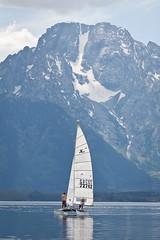 Sails Under the Mountain (Philip Michael Photo) Tags: travel blue mountain lake water boat roadtrip sail wyoming mountmoran grandtetons jacksonlake grandtetonsnationalpark