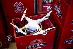 A drone sits in a bintang beer crate. (wrightontheroad) Tags: uluwatu bintang commercial drone localdrink kutaselatan bali indonesia