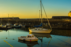 A Golden And Peaceful Cullen (williamrandle) Tags: peaceful cullen banffshire moray northeastscotland quiet harbour 2016 summer wall breakwater boats yacht goldenhour blue reflections buoyant nikon d7100 tamron2470f28vc sea outdoor coast water boat waterfront