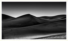 Creeping Light (jfusion61) Tags: greatsanddunesnationalmonument colorado sand dunes black white morning summer light sunrise nikon d810 70200mm high dune texture