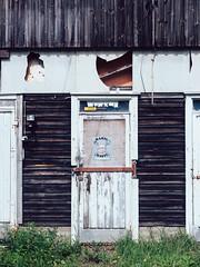 rahti X rasti (miemo) Tags: etelsavo deserted door em5mkii europe finland locked mntyharju olympus olympus1240mmf28 omd rundown sign smalltown summer