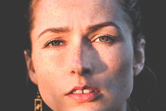 Woman's face (freestocks.org) Tags: adult attractive beauty brunette closeup cold diastema expression eyecontact eyebrow eyelash eyes face fashion female freckle freckles gap girl iris lips look model natural nose outdoor outside people person portrait sensual serious summer sun sunlight teeth woman wrinkles young