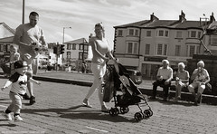 Generations (Ian Betley Photography) Tags: child mother father mummy daddy elderly ice cream morecambe lancashire england uk canon eos 5d mark iii ef24105mm f4l is usm 11600 40 generations family black white mono monochrome street photography ian betley images smiling smile children kid toddler