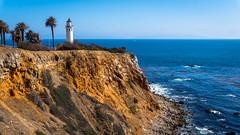 Light House (jmitchell086) Tags: lighthouse ocean beach sky water rocks cliff