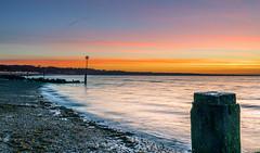 Bands Of Dawn (nicklucas2) Tags: cloud seascape beach beachhut groyne pebble sea wave seaweed seaside