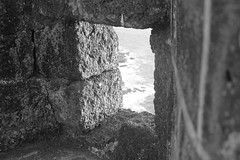 Ratnadurg Fort (sidjohannes) Tags: sea window monochrome stone fort bricks ratnagiri laterite