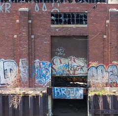 Deliveries (BradPerkins) Tags: city plant streetart chicago building abandoned concrete graffiti factory empty structure urbanexploration silos destroyed urbanlandscape chicagoist damensilos