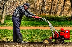 Rototilling The Garden (ezigarlick) Tags: canada man rural garden spring manitoba soil rubberboots tilling rototiller rototilling steanne
