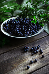 Plate with bilberry on wooden table (azimavu) Tags: plate fruit food wood fresh ripe background group juicy organic diet healthy natural wooden table health summer sweet delicious vitamin berry leaf freshness garden green eat tasty vegetarian raw nature old rustic rusted village dieting blueberry bilberry nutrition eating concept closeup blue surface picked antioxidants plant agriculture fern foodbackground