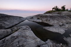 Soft colors of twilight (Kaiser Sozo) Tags: russia  russiannorth  karelia  ladoga  taakionluodot  skerry skerries  lake  island  cliff  stones  rocks granite  underwaterrocks crackontherocks  crack  pond water  standingwater surface  reflection  mirror  sky  clouds  stratus allnightswhite whitenights  twilight  dusk  landscape  waterscape outdoor nature  still  calm peaceful  quite  tranquil tranquility tender