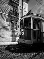 Lisboa 102 (arsamie) Tags: road white black portugal europe cola trolley lisbon capital tram rails coca azulejos paved