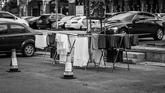 Reserved (Go-tea ) Tags: street urban city china qingdao huangdao outside outdoor bw bnw blackwhite black white canon eos 100d 50mm parking slot laundry wet dry sun cars clothes lines plots space free mops sheet rack stud chinese letters asian asia