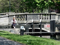 Bridge with Stone Plaque (mikecogh) Tags: wood old bridge dublin woman stone reading alone posts grandcanal