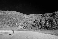 """Badwater Moon Rising"" (helmet13) Tags: d800e raw bw she woman landscape deathvalleynationalpark badwater silence scales umbrella aoi heartaward peaceaward 100faves world100f"