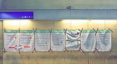 Western Railway Station Vienna during 2015: marked by the refugees drama: Informations in English and Arabic for Families with Children Westbahnhof 2015 Im Zeichen der Flchtlinge. Schon ums Eck in der Lichtgasse zhlt die Form mehr als der Inhalt,... (hedbavny) Tags: taub deaf gebrdensprache arabisch arabic english englisch pfeil zeichen sign kamera berwachungskamera cctv schild tape stein stone mauer wall marmor licht light schatten shadow westbahnhof bahnhof station train leiermann elfenbeinturm realittsflucht glck luck lucky happy glcklich vergesslich blind sthetizismus leier botschaft inhalt form karte map help hilfe hand refugee flchtling asylant flucht graffiti patina mariahilf europaplatz black schwarz red rot weis white blau blue schrift letter buchstabe hedbavny ingridhedbavny wien vienna austria sterreich