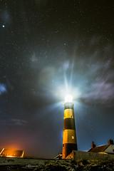 Watcher of the Night (buhamdi) Tags: longexposure ireland light sky lighthouse night clouds newcastle stars lights nikon wideangle astrophotography northernireland northern milkyway d600 northrenireland