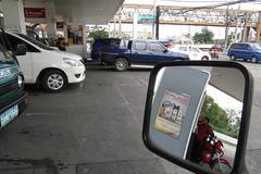 manila petrol station (DOLCEVITALUX) Tags: sidemirror petrolstation station manila philippines canonpowershotsx50hs