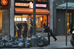 If you want to find all the cops, they are hanging out in the doughnut shop.. . . (Triborough) Tags: nyc newyorkcity ny newyork manhattan police nypd donut doughnut greenwichvillage dunkindonuts newyorkcounty newyorkcitypolicedepartment