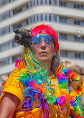 colourful character (sussexscorpio) Tags: rainbow lgbt bubbles colour 2016 pride gaypride brightonpride brightonpride2016 street seafront coast hove hovelawns sunshine color canon canon60d brighton sussex eastsussex parade festival fun carnival people costume glasses sunglasses performance garland outdoor feathers wig