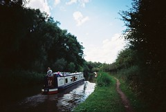 OT500 - Canalboat (johnnytakespictures) Tags: olympus trip500 film analogue automatic kodak colorplus200 expired warwickshire coventy canal river stream towpath walk summer sun sunshire canalboat longboat boat sail sailing motorboat nature natural