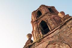 Bantay Church Bell Tower (Jay Cadayona) Tags: travel blue voigtlander philippines olympus vigan nokton omd f095 m43 mft 175mm em5 microfourthirds
