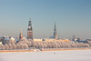 A cyclist rides on the frozen river on background panorama Riga (Viktor Descenko) Tags: old city travel bridge roof winter urban panorama white house building tower castle history tourism church window skyline architecture river pier town frozen high europe cityscape cyclist exterior view place cathedral capital gothic over center scene baltic medieval latvia daytime rides riga daugava
