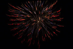 Fire on the Water (aaronrhawkins) Tags: fireworks fire swimmingpool reflection water burst color colorful red blue 4thofjuly july4th celebration shimmer snaking provo utah aaronhawkins