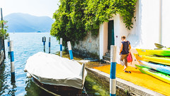 Down to the lake (Nicola Pezzoli) Tags: floating piers lake iseo brescia bergamo blue yellow colors nature canon lombardia italy monte isola sulzano island art design mountain water reflections tourism people boat girl