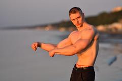 Bodybuilder (Pavels Dunaicevs) Tags: irclv body mass muscles strong man fitness bodybuilding portrait evening summer sea beach bay sand sunset orange bokeh nikon nikkor d750 180mm 40 jurmala latvia sunny sunlight posing bodybuilder water coast baltic ocean young male guy