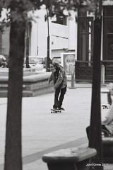 Sheffield on film (Blinkles) Tags: people blackandwhite bw film cityhall stonework sheffield streetphotography skaters buskers townhall hp5 peacegardens fountains grainy cenotaph archways ilford guitarist skateboarders flautist nikonf5 yorkshirebank balmgreen numbuilding