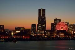 Yokohama at dusk.. (Shubhashish Chakrabarty) Tags: japan 日本 yokohama nikkor minatomirai 横浜 landmarktower tokyobay redbrickwarehouse 夜 都会 横浜みなとみらい21yokohamaminatomirai21