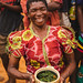 Joyous Woman Holding a Food Plate in Malawi