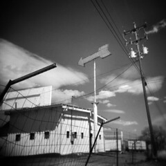 East of Albuquerque (LowerDarnley) Tags: holga newmexico moriarty route66 arrow fence wire building