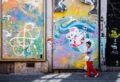 little yellow flowers (ewitsoe) Tags: abstract wall woman walking street ewitsoe nikond80 35mm urban city poznan poland polska europe eu life colorfulart art artist artistic flowers red bright absurd