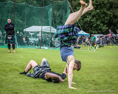 Greg Neilson cartwheels out of a wrestling bout (FotoFling Scotland) Tags: scotland kilt event wrestler balloch cartwheel highlandgames kilted gregneilson lochlomondhighlandgames scottishwrestlingbond benjohnstone wrestlingbond