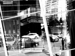 In The City (dawn_macroart) Tags: streetphotography windows reflections mono architecture shapes cars people salfordquays urban bycyles taxies