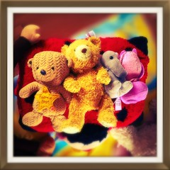My daughter and her Teddies! (frankhimself) Tags: teddybearspicnic teaparty friends funny fun beautiful golden bodies heads legs arms love cute loving warm cuddly soft home scotland bokeh redsyellows daughter colours baby dinosaur teddy