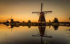 Golden hour (Mika Laitinen) Tags: canon7dmarkii europe kinderdijk leefilters netherlands calm canal cloud color colorful dusk landscape longexposure nature nightfall sky summer sunset twilight water windmills zuidholland nl goldenhour