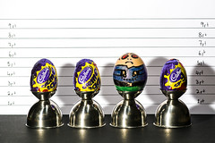Bad Egg (simon.anderson) Tags: easter chocolate egg criminal cadburys eastereggs cremeegg eggcups nikon85mm badegg offcameraflash policelineup heightchart simonanderson policeidentityparade