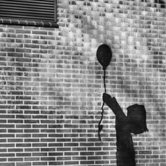 Joy of Life (d_t_vos) Tags: shadow blackandwhite brick thread girl wall barn freedom fly flying holding child release bricks joy balloon shed brickwall string littlegirl grille schwarzweiss liberation hold brickwork setfree outerwall alphenaandenrijn noireetblanc alphenadrijn alphen brickcity joyoflife ventilationgrille airgrate dickvos dtvos