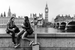 Two girls with coffee in London (Michael Erhardsson) Tags: girls england white black london streetphotography bigben in svartvitt