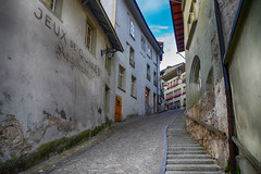 Stairway through Old Town in Fribourg, Switzerland (` Toshio ') Tags: toshio switzerland fribourg swiss stairs stairway oldtown europe european buildings architecture fujixe2 xe2 lampost flowers cobblestone hill city windows