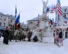 Civilians and GI's lay flowers on place de La République, Carentan, July 14, 1944. (Jared Enos) Tags: world war ii soldiers wwii united states army us carentan france history colorized colorization