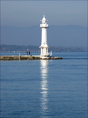Lighthouse at Jet d'eau, Geneva, Switzerland (Wagsy Wheeler) Tags: geneva geneve lake lakegeneva leman lacleman lighthouse switzerland swiss suiss suisse water reflection jetdeau landmark