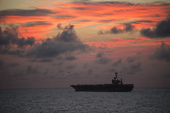 USS John C. Stennis conducts helicopter operations at sunset during Rim of the Pacific 2016.