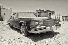 Abandoned Cadillac... (John Konstandis) Tags: car cadillac abandoned dust old qatar blackandwhitephotography blackwhite canoneos5dmarkiii canonef1635mmf4lisusm monochrome