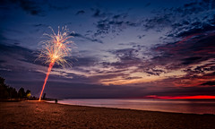 beach sparkler (JimfromCanada) Tags: firework beach water waterfront lake sunset evening portelgin ontario couple alone pretty sky cloud red sparkle special glow canada
