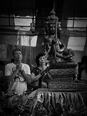 Faith is seeing light with your heart when all your eyes see is darkness (ivnseow) Tags: street travel heritage history tourism face architecture asian temple four singapore asia buddha faith religion pray praying buddhism taoism oray